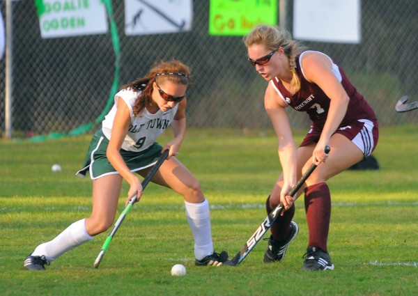 Old Town's Emma Cyr (left) and Foxcroft Academy's Julia Annis battle for the ball during the second half in Old Town on Tuesday afternoon.