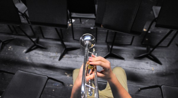 Trumpet player Noah McCarthy warms up before the rehearsal of the Bangor Symphony Youth Orchestras at the Bangor High School.