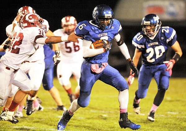 Lewiston's Quintarian Brown slips through the fingers of Bangor's Dane Johnson in the first quarter of their game Friday night in Lewiston.