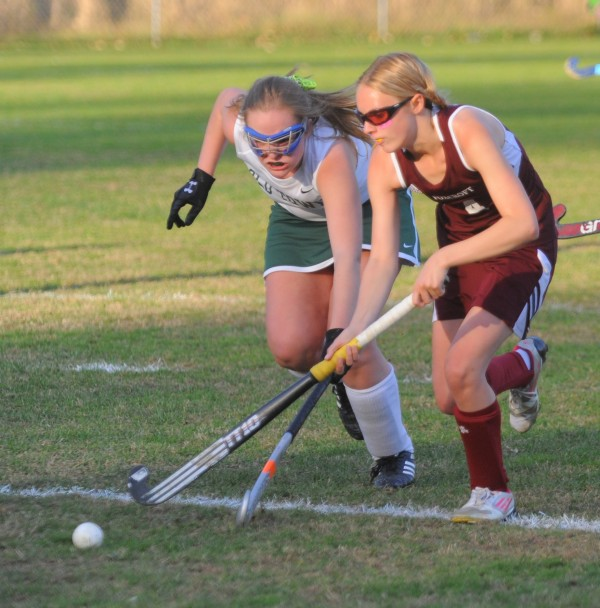 Foxcroft Academy's Madison Fadley (right) seeks control of the ball while pressured by Old Town's Taylor Bowers during the second half of the game in Old Town on Tuesday afternoon.
