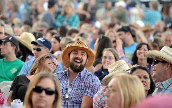 Fans have a good time while waiting for the &quotNo Shoes Nation Tour 2013&quot concert to begin with the Eli Young Band and Kenny Chesney at the Darlings Waterfront Pavilion in August.
