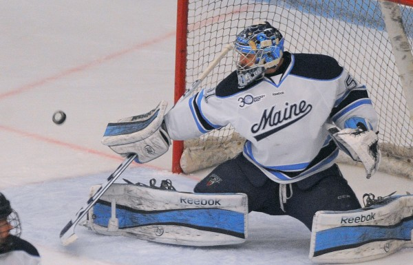The University of Maine's Martin Ouellette makes a save during the game against  UMass in Orono Saturday.