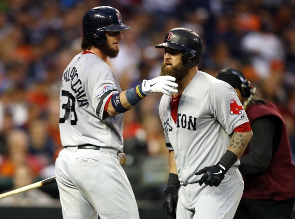 Boston's Mike Napoli (right) celebrates his home run against the Detroit Tigers with Red Sox teammate Jarrod Saltalamacchia during the seventh inning in game three of the American League Championship Series at Comerica Park in Detroit Tuesday.