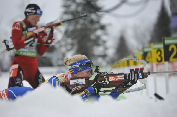 Friday's top two finishers, Helena Ekholm (right) of Sweden and Tora Berger of Norway shoot their first prone bout during the  I.B.U. World Cup women's 10 kilometer pursuit at the Nordic Heritage Center in Presque Isle, Maine on Sunday, Feb. 6, 2011.
