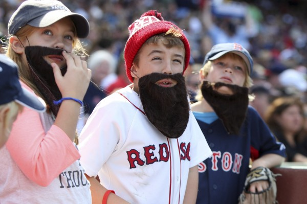 Three fans wear fake beards in support of the Red Sox as the team faces the Toronto Blue Jays in their MLB American League East baseball game in Boston, Massachusetts, September 22, 2013.