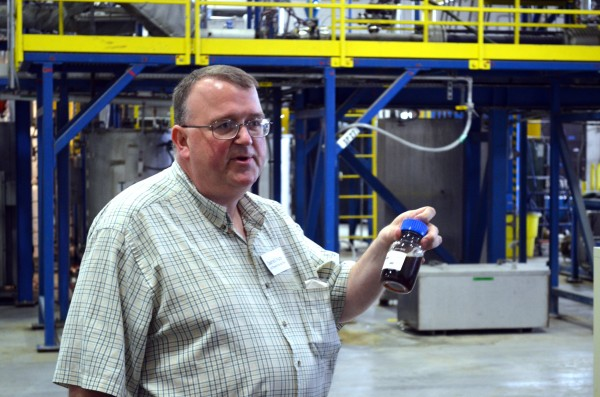 Darrell Waite, process manager at Old Town Fuel and Fiber, holds a container of cellulosic sugar, that is made from wood products.