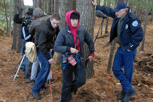 "Sound recordist Susan Bryant, center, and crew member Donnacha Breheny, left, hustle for the next shot during shooting of ""&quotThe Girl in the Lake&quot"" in Millinocket on Tuesday, Oct. 8, 2013."