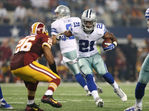 Dallas Cowboys running back Joseph Randle (21) runs with the ball against Washington Redskins cornerback Josh Wilson (26) in the third quarter at AT&T Stadium Sunday night. The Dallas Cowboys beat the Washington Redskins 31-16.