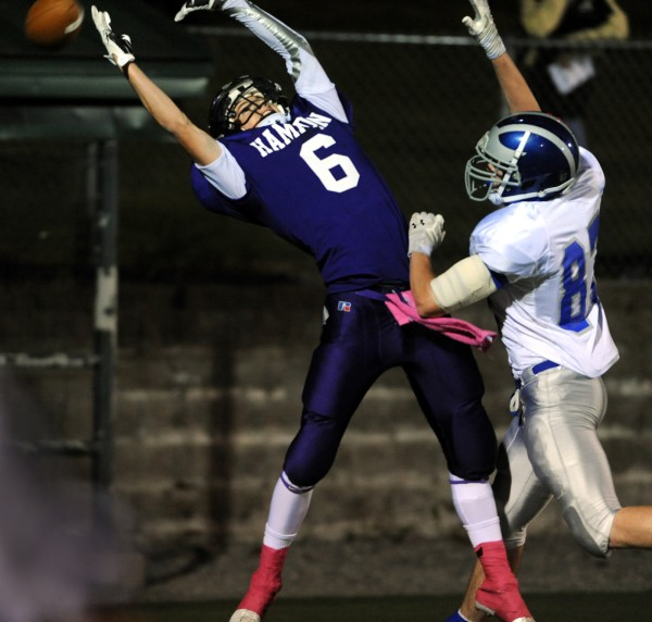 Hampden's Matt Closson just misses a touchdown pass as Lawrence's Seth Powers blocks the quarterback's pass in first half action of Friday night's game at Hampden.