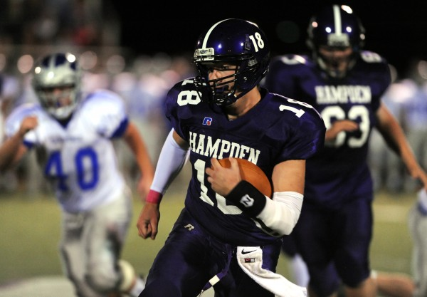 Hampden quarterback Matt Martin runs the ball in first half action of Friday night's game against Lawrence High School at Hampden.