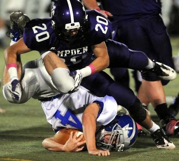 Hampden Bronco's Bill Campbell brings down Lawrence's Phil Gadway in first half action of Friday night's game against at Hampden.