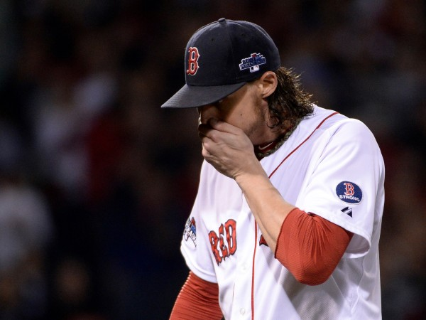 Boston Red Sox starting pitcher Clay Buchholz walks back to the dugout after being relieved during the sixth inning against the Detroit Tigers in Game Six of the American League Championship Series at Fenway Park
