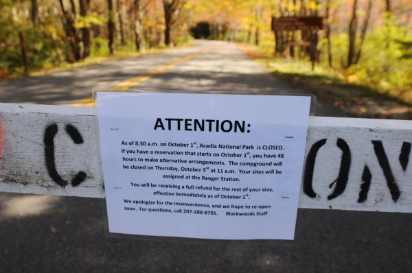 A sign at the entrance of Blackwoods Campground in Otter Creek informs campers on Tuesday of the campground's closure because of the federal government shutdown. Seventy-three campers were at the campground on Tuesday and had until 11 a.m. Thursday to leave
