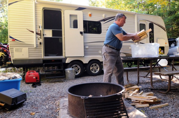 Jeffrey Hunter of Rochester, N.Y., packs up his wood supply he brought for his two-week stay at Blackwoods Campground in Acadia National Park on Tuesday. Campers were given 48 hours to vacate after the federal government shut down at midnight Monday. All campers are being given a full refund.