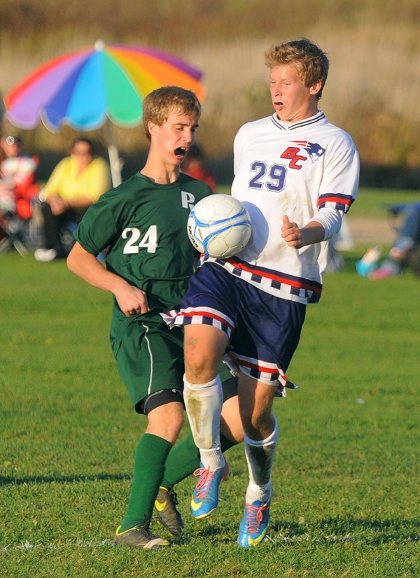 Bangor Christian's Jay Bishop (right) settles the ball while pressured by Penobscot Valley's Parker McLaughlin during the first half in Bangor Thursday.