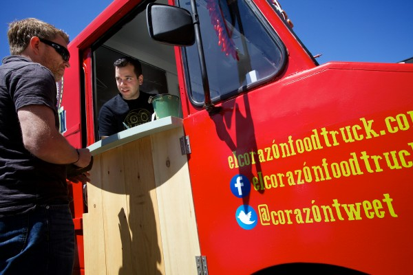 Jeff Jackson (left) orders lunch from Miles Perry at the El Corazon food truck on Spring Street in Portland on May 15, 2013. Jackson works nearby.
