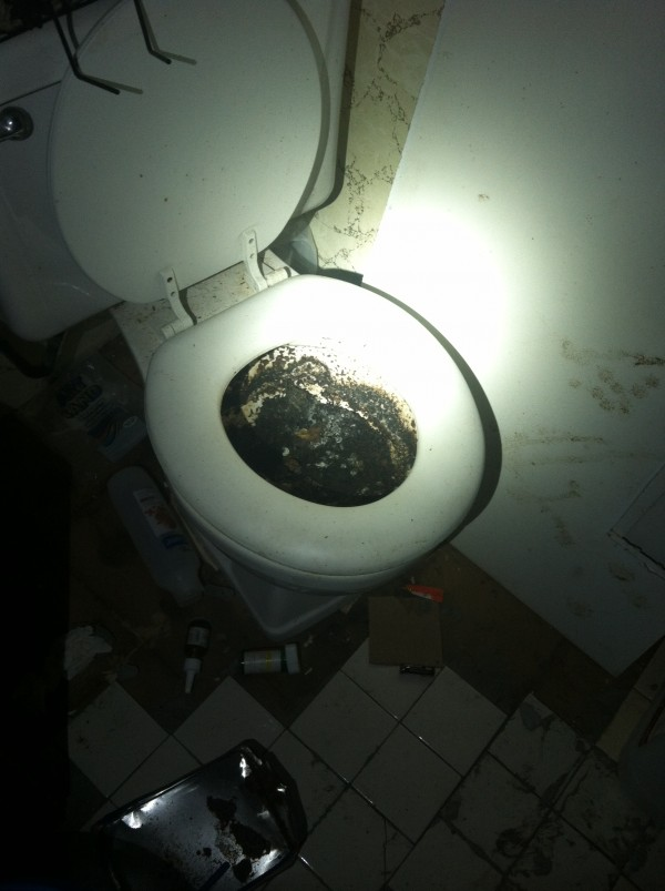 The blackened toilet in the dilapidated residence at 4 Somerset St. in Brewer.