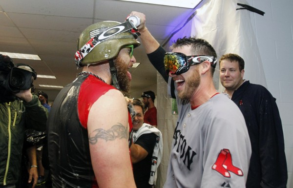 Boston Red Sox left fielder Jonny Gomes (left) and shortstop Stephen Drew (right) congratulate each other with beer in the locker room after they beat the Tampa Bay Rays of game four of the American League divisional series at Tropicana Field. Boston Red Sox defeated theTampa Bay Rays 3-1.