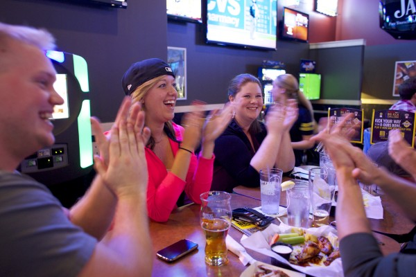 Ryan Hawes of Auburn (from left), Stephanie Chick of Fort Kent, Kerry Hafford of Bangor, Joel Hatfield of Portland and Chris Farrar of Waterville cheer during a three-run first inning for the Red Sox on Wednesday evening at Buffalo Wild Wings in Bangor.