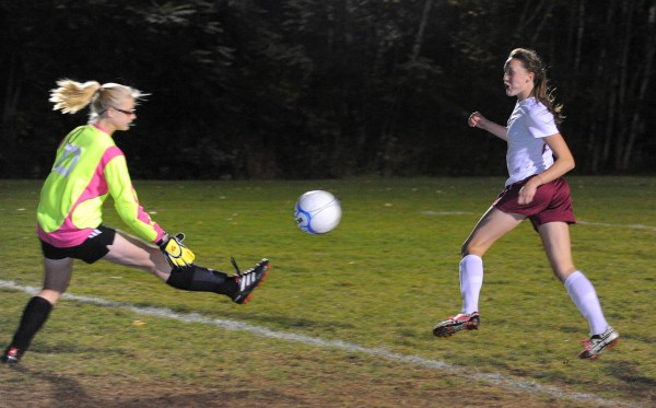 Cony High School's goalkeeper Autumn Sudsbury (left) makes a save on a shot by Bangor High School's Mary Butler during the first half of the game in Bangor Tuesday evening.