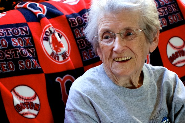 Ginny Tardiff, 99, sits on her couch in her Lisbon living room where she watches the Red Sox on television.