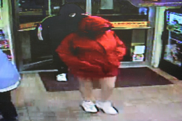 Brunswick police are searching for a man and woman who allegedly robbed the Big Apple store on Pleasant Street Friday night. The woman is described as 5 feet, 4 inches tall, 220-240 pounds, and was wearing a red hooded winter coat, bare legs and white sneakers.