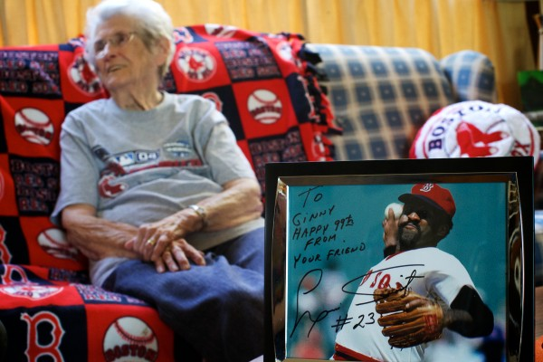 Ginny Tardiff, 99, of Lisbon sits in her living room near an autographed picture of former Red Sox pitcher Louis Tiant.