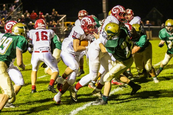 Bangor's Logan Lanham (27) runs for second-quarter touchdown behind the block of Dane Johnson against Oxford Hills Friday night in South Paris. Bangor went on to win 27-6.