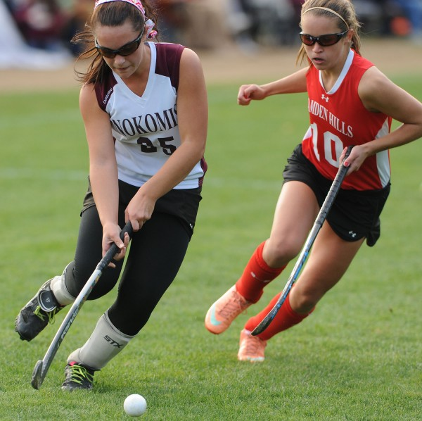 Nokomis' Kirsten Costedio pushes the ball ahead of Camden Hills' Emily Daggett during first-half action in Newport on Thursday.