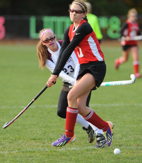 Nokomis' Taylor Shaw blasts a shot past Camden Hills' Molly Davee during first-half action in Newport on Thursday.