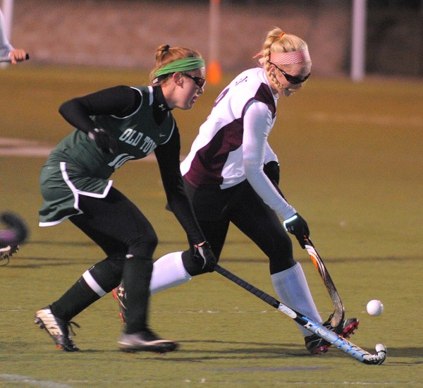 Old Town's Ali King (left) battles for the ball with Nokomis' Lindsay Whitney during the first half of the Eastern Maine Class B championship game in Hampden Tuesday.