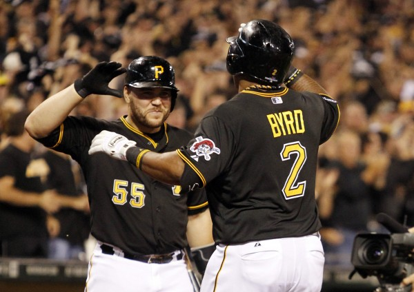 Pittsburgh's Marlon Byrd (2) is congratulated by  Russell Martin (55) after hitting a solo home run against the Cincinnati Reds in the second inning of the National League wild-card playoff baseball game Tuesday night in Pittsburgh.