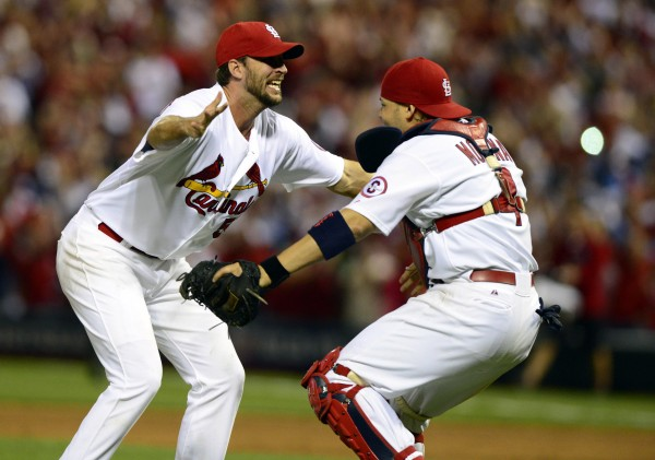 St. Louis Cardinals starting pitcher Adam Wainwright (left) celebrates with catcher Yadier Molina after defeating the Pittsburgh Pirates in game five of the National League divisional series at Busch Stadium in St. Louis. The Cardinals won 6-1.