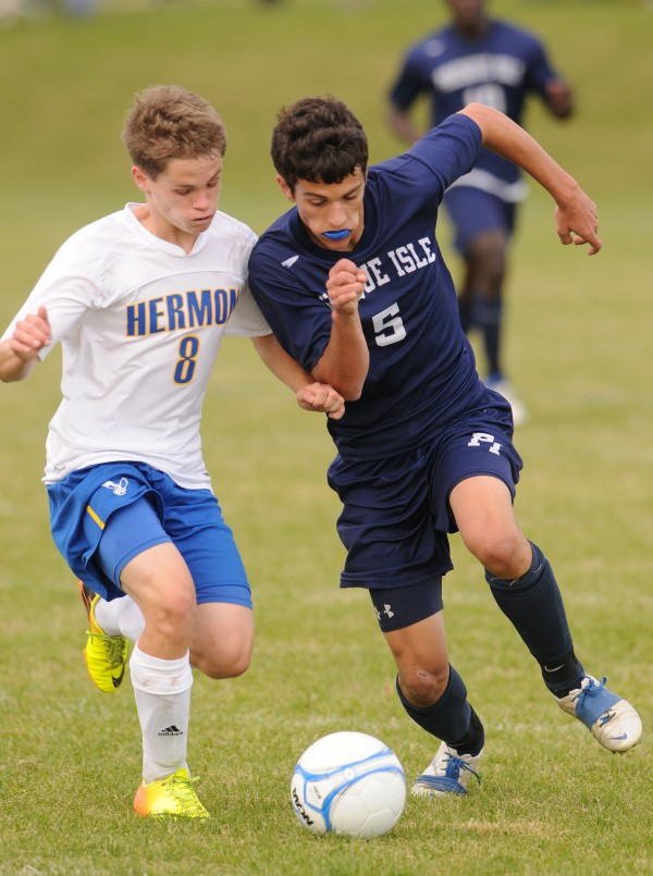 Presque Isle's Ben Nickerson and Hermon's Nathan Mixer vie for control of the ball  during first half action at Hermon on Monday.