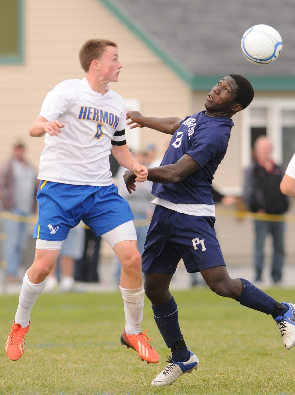 Hermon's Timothy Verrill and Presque Isle's Ansumana Morrow vie for the header during first half action at Hermon on Monday.