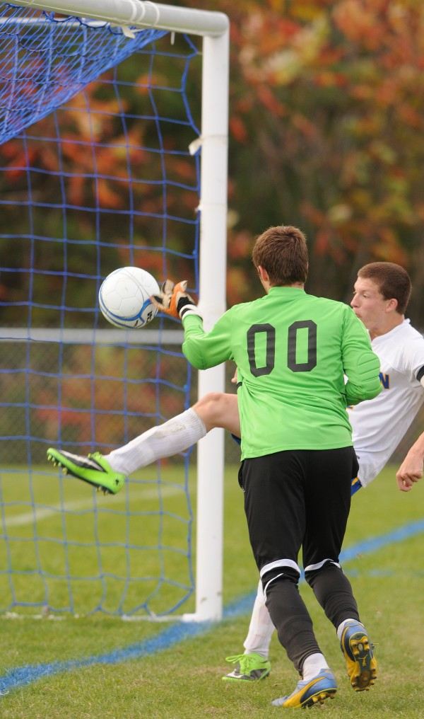 Hermon's Matt Cullens and Goal Keeper Garrett Kipler attempt to save the ball from entering the net against Presque Isle on Monday. Alex Michaud was credited with the score during first half action at Hermon on Monday.