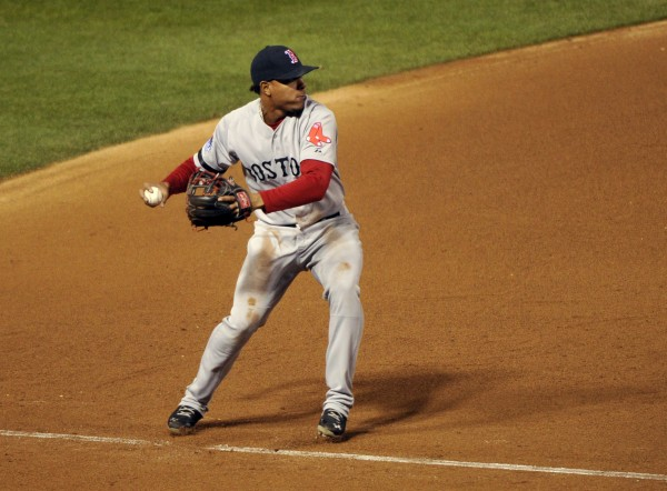 Boston Red Sox third baseman Xander Bogaerts (72) throws to first base against the St. Louis Cardinals during the eighth inning of game four of the MLB baseball World Series at Busch Stadium.