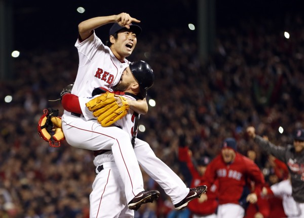 Boston Red Sox relief pitcher Koji Uehara (19) reacts with catcher David Ross (3) after defeating the St. Louis Cardinals in Game 6 of the World Series at Fenway Park in Boston. The Red Sox won 6-1.