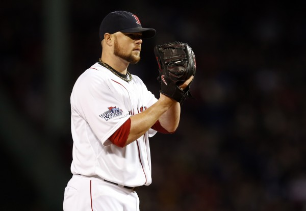 Boston Red Sox starting pitcher Jon Lester (31) looks for a sign against the St. Louis Cardinals during the fifth inning of game one of the World Series at Fenway Park.