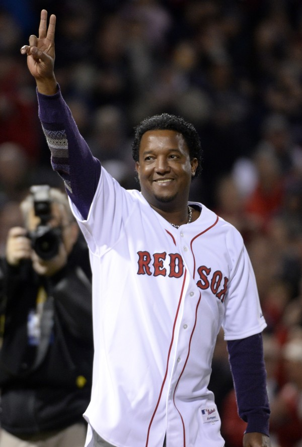 Former Boston Red Sox pitcher Pedro Martinez waves to the crowd before game two of the World Series against the St. Louis Cardinals at Fenway Park.