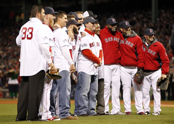 Members of the Boston Red Sox pose for a photo with members of the 2004 Red Sox after they threw out the ceremonial first pitch prior to game two of the World Series against the St. Louis Cardinals at Fenway Park.