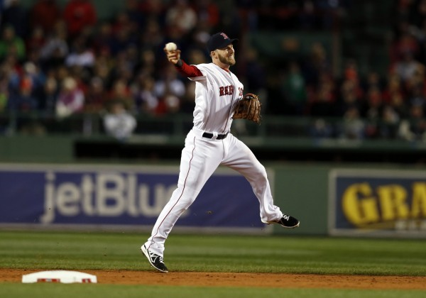 Boston Red Sox shortstop Stephen Drew (7) throws to first base for the out against the St. Louis Cardinals during the fifth inning of game two of the World Series at Fenway Park.