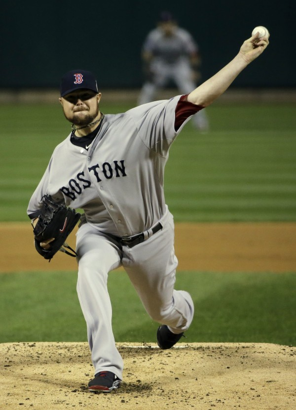 Boston Red Sox starting pitcher Jon Lester throws a pitch against the St. Louis Cardinals in the first inning during game five of the World Series at Busch Stadium.