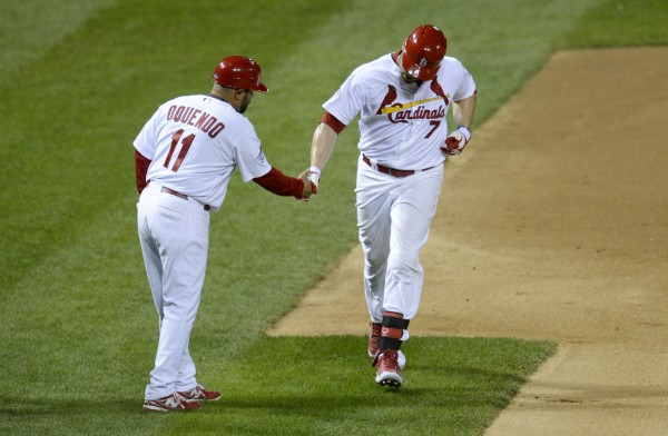 St. Louis Cardinals left fielder Matt Holliday (7) celebrates with third base coach Jose Oquendo (11) after hitting a solo home run against the Boston Red Sox in the fourth inning during game five of the World Series at Busch Stadium.