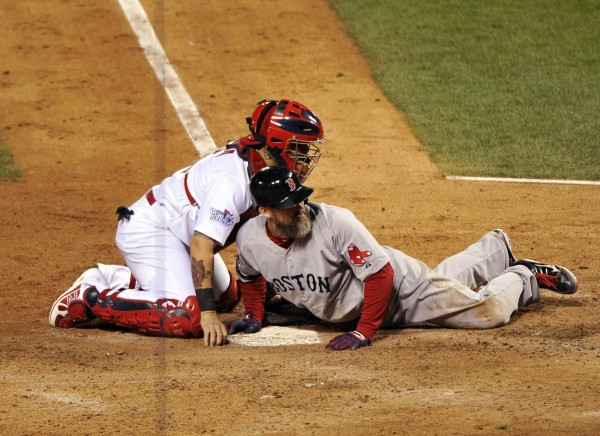 St. Louis Cardinals catcher Yadier Molina (4) tags out Boston Red Sox catcher David Ross (3) at home plate to end the seventh inning of game five of the World Series at Busch Stadium.