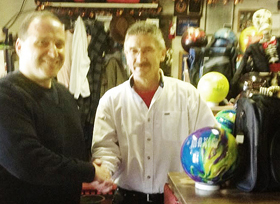 Councilman Baldacci and Andy Meucci of Family Fun Lanes. Andy is donating a twelve pound bowling ball and bag to be auctioned off at the Oct 30th &quotsave the buss route&quot Baldacci spaghetti dinner.