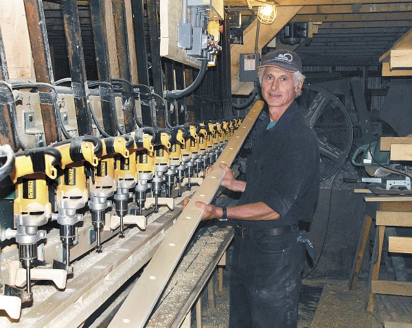 This manufacturing machine was designed by Peter Baldwin, who owns Baldwin Apple Ladders in Brooks. The machine features 19 identical DeWalt hand drills mounted on a framework; at the press of a button, all of the drills bore holes simultaneously in the ladder frames to prepare to have ladder rungs mounted to them.