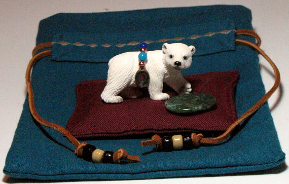 Teaches nurturance.  Sweet little bear cub comes with soft dream pillow, worry/wishing stone in which to serve his favorite (cornmeal), and turquoise beaded pouch.