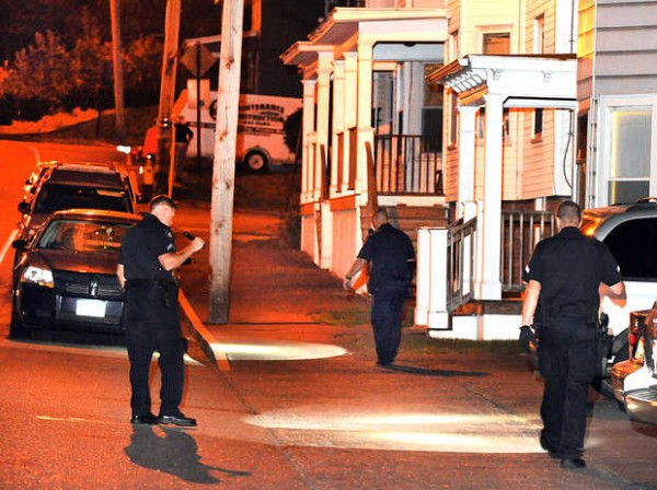 Lewiston police follow a trail of blood up Ash Street in Lewiston on Thursday night. A man was taken to the hospital by ambulance from the corner of Walnut and Shawmut streets. Police had the corner of Ash and Howard streets blocked off with crime-scene tape.