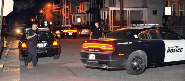 Lewiston police look for evidence in a stabbing at the corner of Ash and Howard streets in Lewiston on Thursday night.
